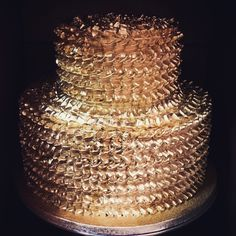 Two-tiered Coconut-Pineapple Cake piped with vanilla buttercream and decorated with gold dust.