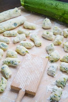 Zucchini Ricotta Gnocchi     4 cups zucchini, grated     1 tablespoon salt     1/4 cup loosely packed basil, sliced      2 teaspoons lemon zest (optional)     1 1/2 cups ricotta     2 egg yolks     1/4 cup parmigiano, grated     1/4 teaspoon pepper     1 cup flour