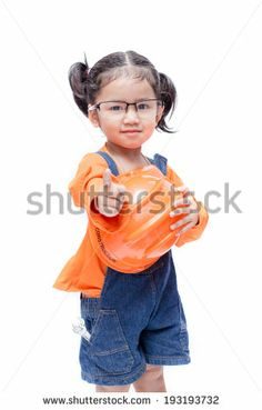 Asian Engineer baby girl Pointing on white background - stock photo