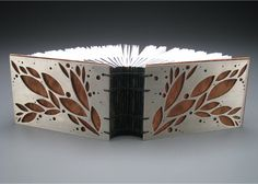 "Greek Binding by Theresa Marr.   4"" x 6"" x 3"" Nickel Silver, Paper, Redwood Burl Veneer, Linen Thread 2010"