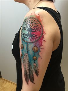 amazing watercolor aquarell dream catcher done at tattoo anansi Munich on arm
