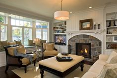 Parade 2009 traditional living room... love the arch and stone fireplace surround