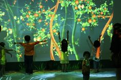 Theo Watson 2009  'Funky Forest' is an interactive ecosystem where children create trees with their body and then divert the water flowing from the waterfall to the trees to keep them alive. The health of the trees contributes to the overall health of the forest and the types of creatures that inhabit it.  http://www.theowatson.com/site_docs/work.php?id=45