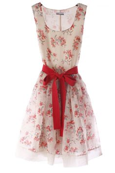 The Donna Dress by Red Valentino is sublime. In a multicolored floral-print layered silk organza with a red cotton ribbon waist, full skirt, reinforced hem, fully lined, concealed zip fastening.