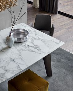 Detail of Howard table with mat calatatta oro marble top.