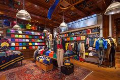 "POLO RALPH LAUREN GLOBAL FLAGSHIP STORE, NEW YORK, ""Polo's Shirts Color-Coordinated Display Wall"", pinned by Ton van der Veer"