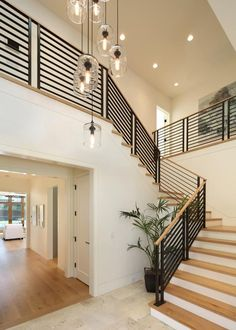 Take a peek at this high contrast staircase with glass pendant lights on HGTV.com.