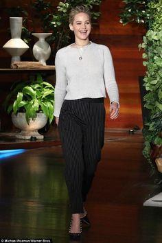 Jennifer Lawrence wearing Altuzarra Elliot Pearl Pumps and Stella McCartney Kassidy Belted Pinstripe Pants
