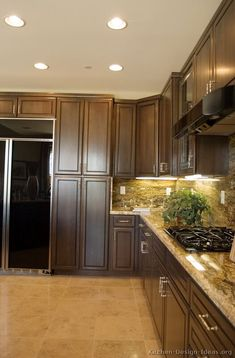 #Kitchen Idea of the Day: Deliciously Dark Walnut-Colored Kitchen with black appliances.