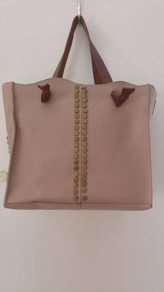 A Gorgeous Womens Boho Shoulder Leather Personalized Bag Spacious, sophisticated and chic, this gorgeous nude tote leather embellished with studs, is a must-have leather bag. With the monogram you can make this beautiful designer bag into your own one of a kind bag.  It is roomy, functional and versatile, with two handles to carry over your shoulder.  You can use it everywhere every day and for any occasion, and it will add charm, elegance and sophistication to your appearance.  This bag is…