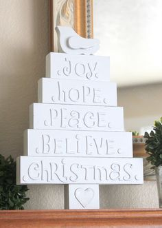 Wooden blocks, puffy letter stickers, spray paint I love this idea