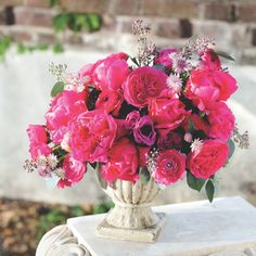 In Charleston, Heather Barrie of Gathering Floral & Event Design conceives landmark arrangements combining a spring palette with old patina settings.     anemones     'Rosea' astrantia     freesia     'Baronesse' garden roses     'Felix Supreme' peonies     'Paula Fay' peonies     ranunculus     seeded eucalyptus