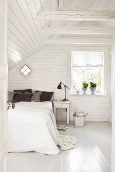 White-painted wood, the perfect backdrop for a white bedroom. @Christina Childress La Celle  I LOVE this with the exposed beams. The cabin design makes it feel more welcoming. I could totally go for all white if it looked like this!