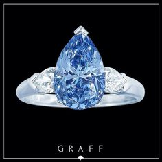 An exceptionally rare 3.32ct Fancy Vivid Blue Pearshape diamond ring by Graff Diamonds.