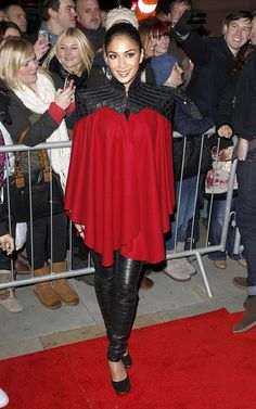 Nicole Scherzinger at the X-Factor UK Finals Press Conference in Manchester, England in a Jad Ghandour Fall 2012 cape dress, a pair of leather Gareth Pugh pants, and Carvela Ardent Pumps.