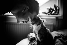 These charming photos of cats and men—from punk rockers to grandpas to the guy next door—will melt your heart.