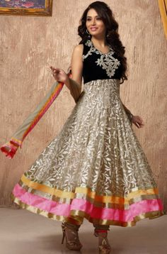 Get your look revamped with this beautiful cream colour party wear Anarkali salwar suit which is made of net fabric. It's beautified with thread embroidery.