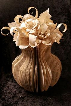 Beautiful and creative sculptures made out of pages of recycled books by talented artist Jodi Harvey-Brown.