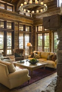 French doors, windows, floating furniture area, rustic wood walls and floors, clerestory windows, rugged rock fireplace and a timber mantle...