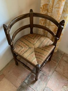 Beautiful antique corner chair with multicolor rush seat