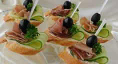 Canapes with ham by Apolonia. Mini sandwiches with ham and cucumber on a baguette Vegetable Appetizers, Finger Food Appetizers, Appetizers For Party, Finger Foods, Tapas, Canapes Recipes, Appetizer Recipes, Food Design, Party Food Platters