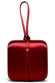 This lovely red satin clutch is the perfect accessory for a glamorous woman going to a formal affair....