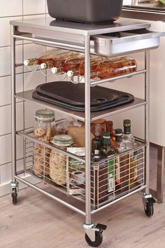 Grundtal Stainless Steel Kitchen Trolley Loaded With Bottles And Glass Jars