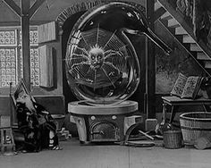 The Mysterious Retort is a 1906 film by A wizard sleeps at a table in his well-appointed sitting room. From a drawer in the table, a snake appears. The snake begins a series of transformations: he becomes a jester, a spider, and a woman. Each approaches the wizard as he sleeps. Each also works its magic on a glass vial on the wizard's table. Soon the vial has grown in size and is full of a bubbling liquid.