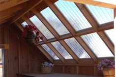 Clear PVC roofing panels made by Palruf and sold at Home Depot - less expensive translucent material for a sunroof, greenhouse, or porch deck cover, but still lets in lots of light.