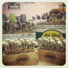 Beer inspired cakepop display featuring hell yeah, florida crack and jai alai beer. Beer mugs as well.