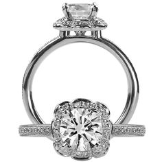 Floral diamond engagement ring featuring a scalloped halo with a prong set round cut centerstone with a single row pavé diamond shank.