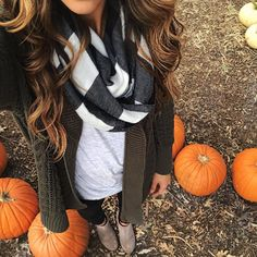 Checkered scarf, light gray tunnel c, olive cardigan, skinniest and booties