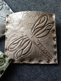 x clay wall pocket with inlaid vintage lace and dragonfly imprint. Hand Built Pottery, Slab Pottery, Thrown Pottery, Ceramic Wall Art, Ceramic Clay, Pottery Designs, Pottery Ideas, Ceramics Projects, Ceramics Ideas