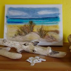 A personal favourite from my Etsy shop https://www.etsy.com/uk/listing/505012170/needle-felted-beach-scene-beach-picture