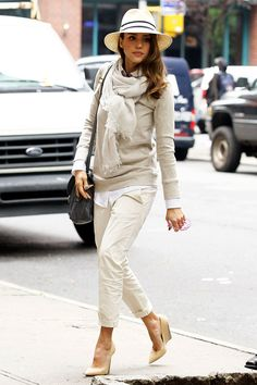 The versatility of a cream crew-neck jumper and beige chino pants makes them investment-worthy pieces. Add tan leather wedge pumps to your look for an instant style upgrade.   Shop this look on Lookastic: https://lookastic.com/women/looks/crew-neck-sweater-dress-shirt-chinos/22581   — Beige Straw Hat  — Beige Lightweight Scarf  — Beige Crew-neck Sweater  — Black Leather Crossbody Bag  — White Dress Shirt  — Beige Chinos  — Tan Leather Wedge Pumps