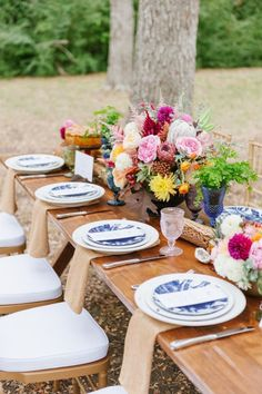 Sophisticated table setting featuring fresh flowers.