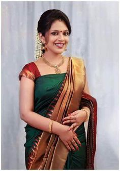 I have purchased a green colour silk saree the AMT but instead of this I have received low quality pink coloured saree from the great Indian sarees Indian Bridal Sarees, Bridal Silk Saree, Indian Silk Sarees, Pure Silk Sarees, Saree Wedding, Indian Designer Outfits, Indian Outfits, Kerala Saree Blouse Designs, Engagement Saree