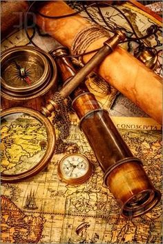 Picture of Vintage magnifying glass, compass, telescope and a pocket watch lying on an old map. stock photo, images and stock photography. Vinil Wallpaper, Bateau Pirate, Pirate Life, Old Maps, Vintage Maps, Vintage Antiques, Antique Maps, Vintage Items, Magnifying Glass