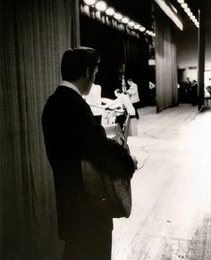Elvis Presley waiting in the wings of the Mosque stage (June 30, 1956).