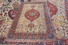"""This splendid antique handmade Persian Isfahan wool carpet revives the quality and craftsmanship expected from city rugs after the First World War. Measuring 340x245cm (11'2""""x8') and made around the early 20th century, it has hunting scene with an eye catching central medallion decorated with various birds, animals, flowers and scrolling vines in amazingly pale gold main field."""