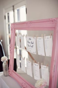 paint a frame in your preferred color, string cord across and pin you seating chart with mini clothes pins!