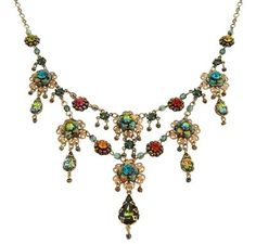 A gorgeous flowers with tear drops Michal Negrin necklace from the Michal Negrin Classic collection. This necklace comes to you on a 16 inch to 18 inch adjustable chain. Each Michal Negrin jewelry ite