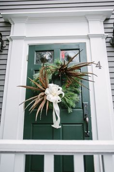 This gorgeous custom Christmas wreath!! (on a home in Nantucket by Betsey Brooks Floral & Design)