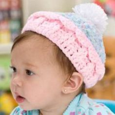 This super-cute crocheted cupcake hat from Red Heart Yarn is one of our favorite free crochet baby hat patterns. It's adorable and warm!