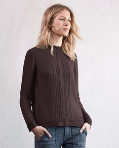 Clemence blouse - Wrap London - Neat fitting, in slinky, silk-like viscose crepe, this high-necked, lace-trimmed blouse has pretty lace inserts and a pleated front panel. Contemporary details with covered buttons down the back and a hemline that is slightly longer at the back. 100% viscose.