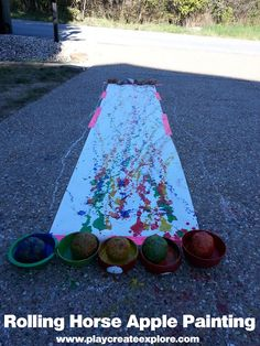 This looks like a fun summer game. Roll the apples and make a painting!