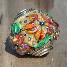 Delicious focal capped bead by Angie of Beadaddicts. $55.00