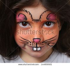 Mouse Face Painting | Pretty girl with face painting of a mouse - stock photo