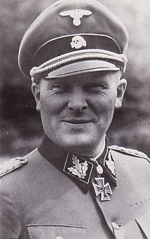 """SS-Brigadeführer and Generalmajor of the SS Theodor Peter Johann Wisch (13 Dec 1907 – 11 Jan 1995) Knight's Cross on 15 Sep 1941 as SS-Sturmbannführer and commander of the II./""""Leibstandarte SS Adolf Hitler""""; 393rd Oak Leaves on 12 Feb 1944 as SS-Brigadeführer and Genmajor of the SS, and commander of the 1. SS-Panzer-Division """"Leibstandarte SS Adolf Hitler""""; 94th Swords on 30 Aug 1944 as SS-Brigadeführer and Genmajor of the SS, and commander of the 1. SS-Panzer-Division """"Leibstandarte SS AH"""