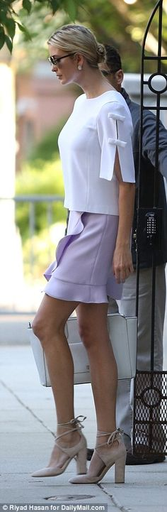 The 35-year-old looked elegant in a lilac purple skirt featuring ruffles and a stark white top